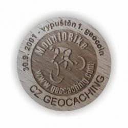 První geocoin